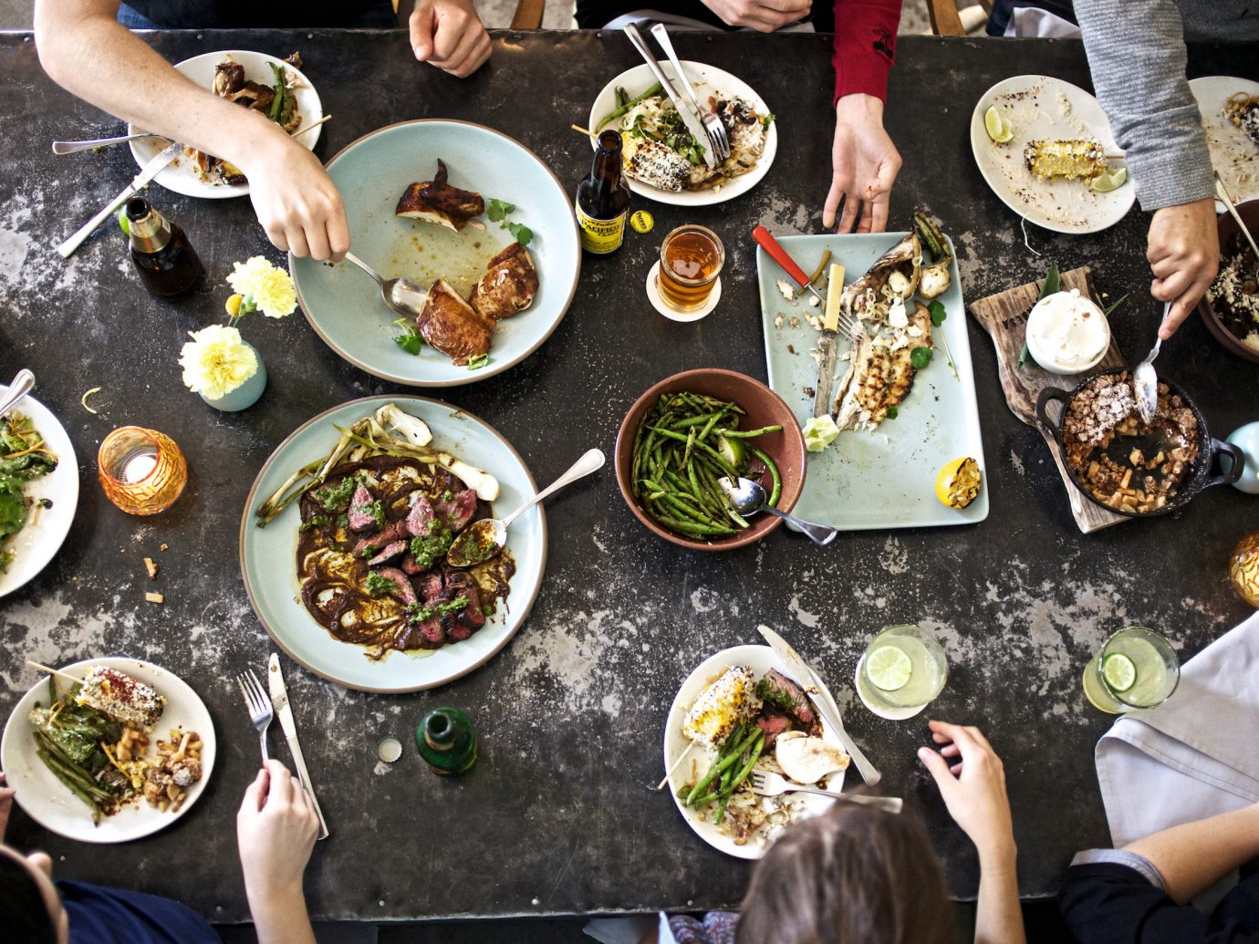 Arts + Culture Austin Nashville Trip Ideas food person plate dish meal group sense lunch different bunch several meat