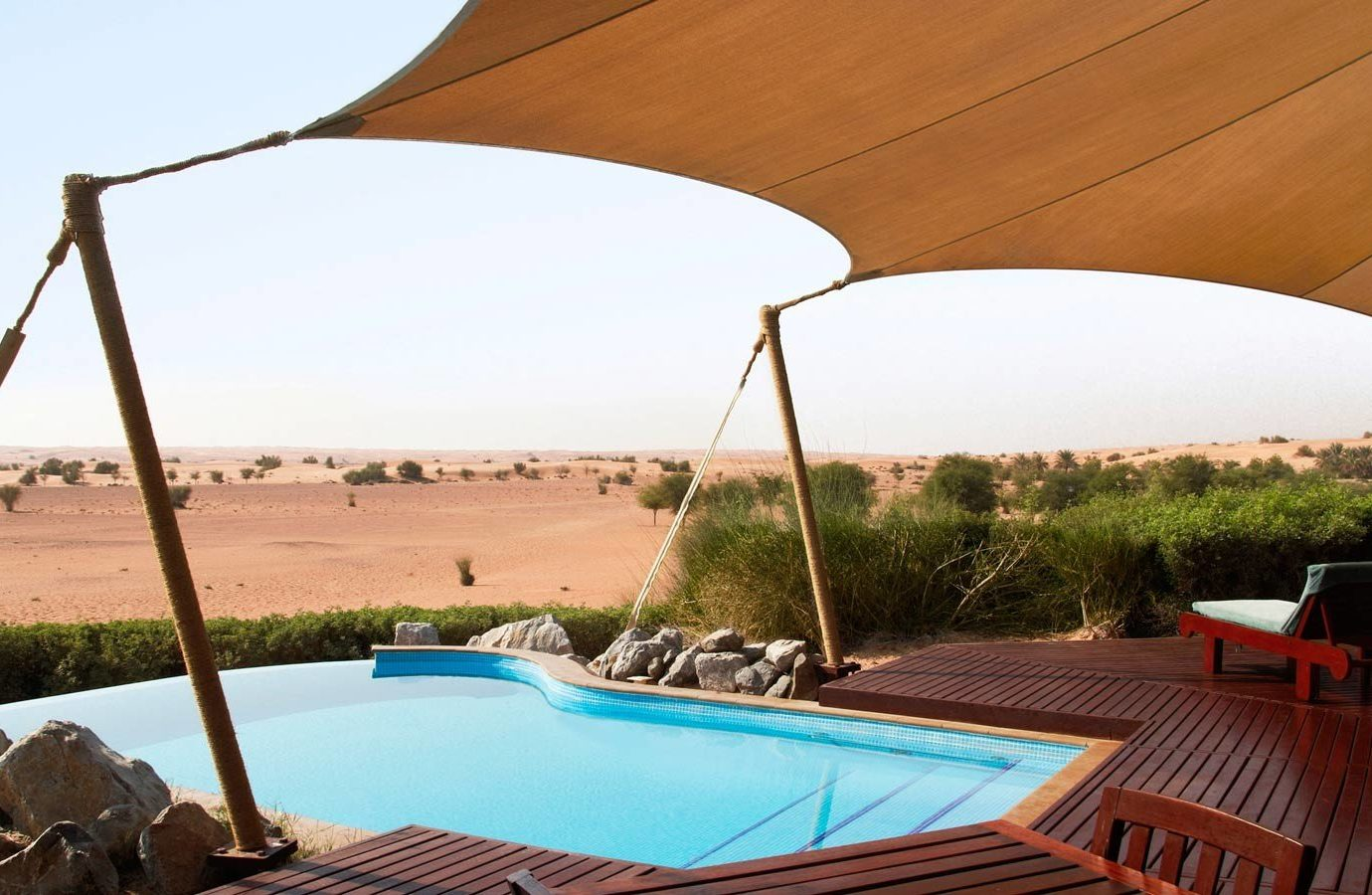 Dubai Hotels Luxury Travel Middle East property shade tent swimming pool vacation canopy leisure outdoor structure real estate estate sunlounger landscape roof outdoor furniture umbrella Resort backyard Villa