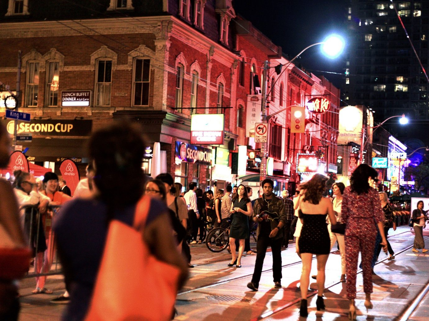 Budget building person outdoor street crowd people walking road night City group evening way pedestrian busy