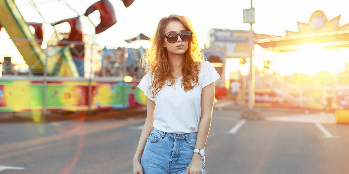 fashion Packing Tips shirt style Style + Design Travel Shop person clothing photograph yellow jeans outdoor girl snapshot fun shoulder vacation sunglasses shorts cool summer happiness vision care smile trousers denim leisure