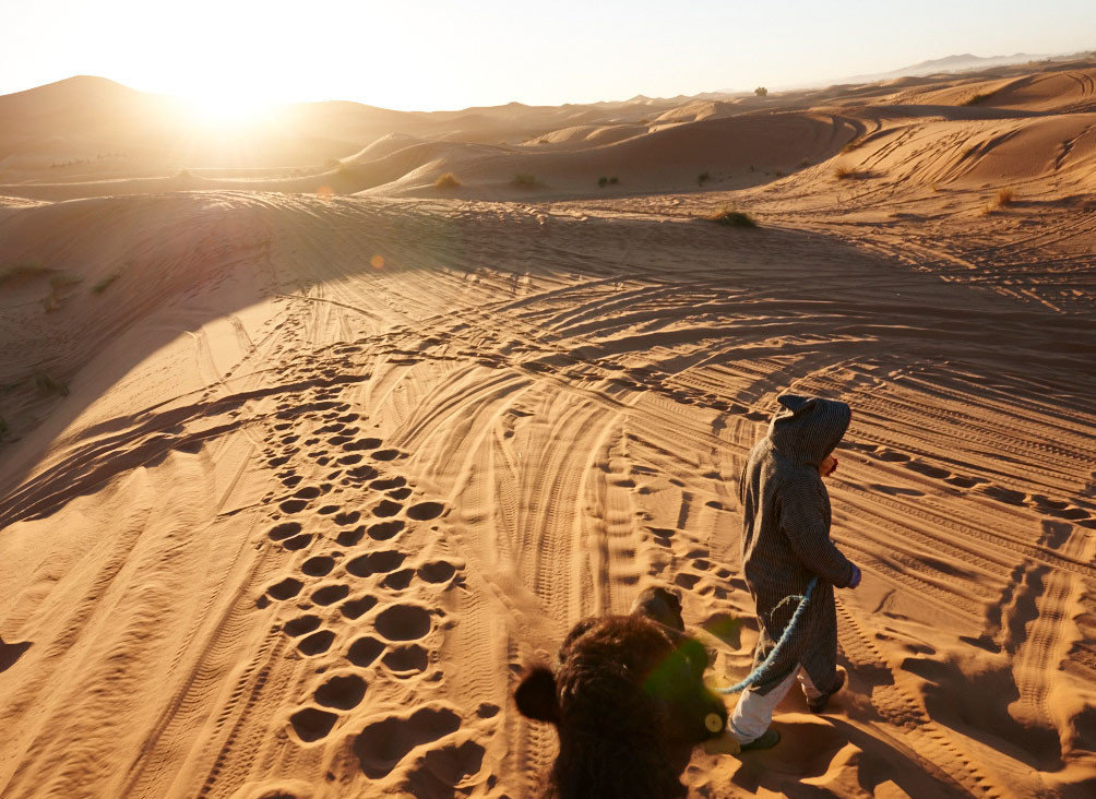 Jetsetter Guides Road Trips sky outdoor habitat erg natural environment geographical feature landform sahara aeolian landform Desert ecosystem sand landscape wadi Nature plateau