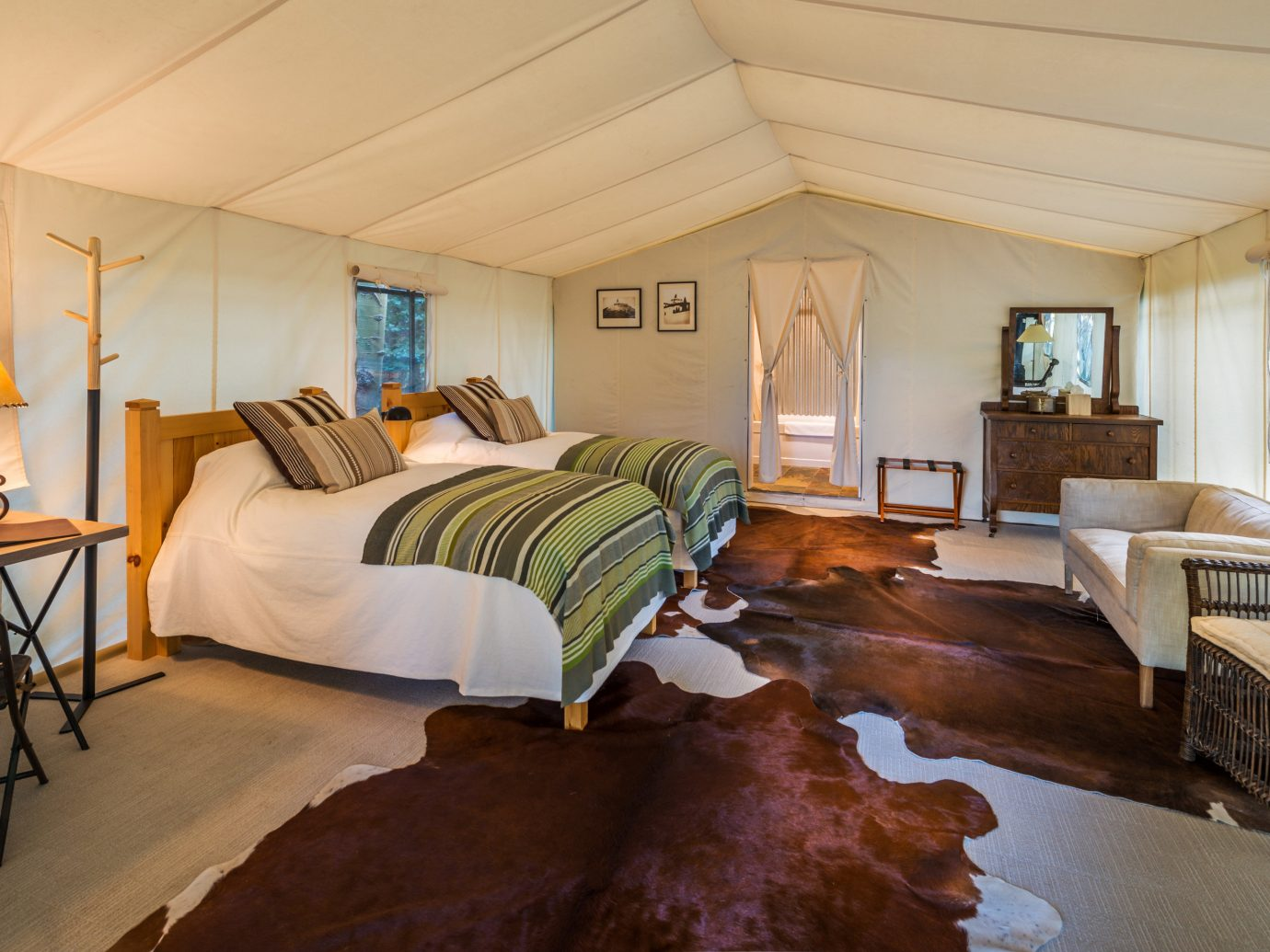 Glamping Outdoors + Adventure Trip Ideas Weekend Getaways indoor wall room floor ceiling Living property estate Bedroom home real estate cottage hardwood Villa living room Suite interior design mansion farmhouse furniture area several