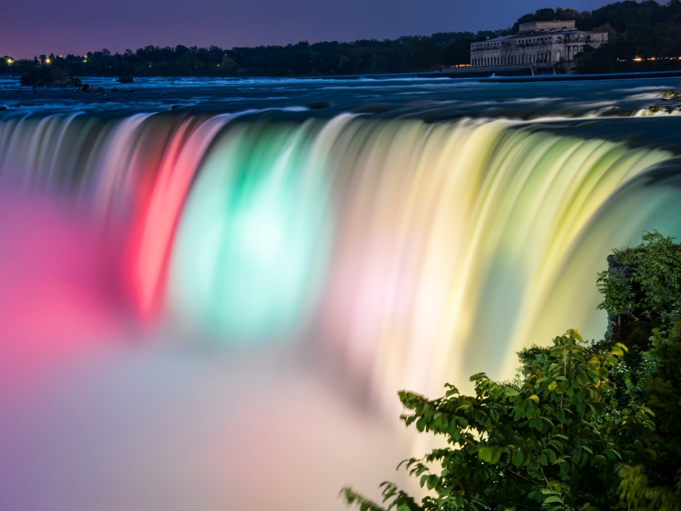 Hotels Offbeat Trip Ideas tree outdoor Nature atmospheric phenomenon reflection water atmosphere morning rainbow water feature sunlight Waterfall colorful colored