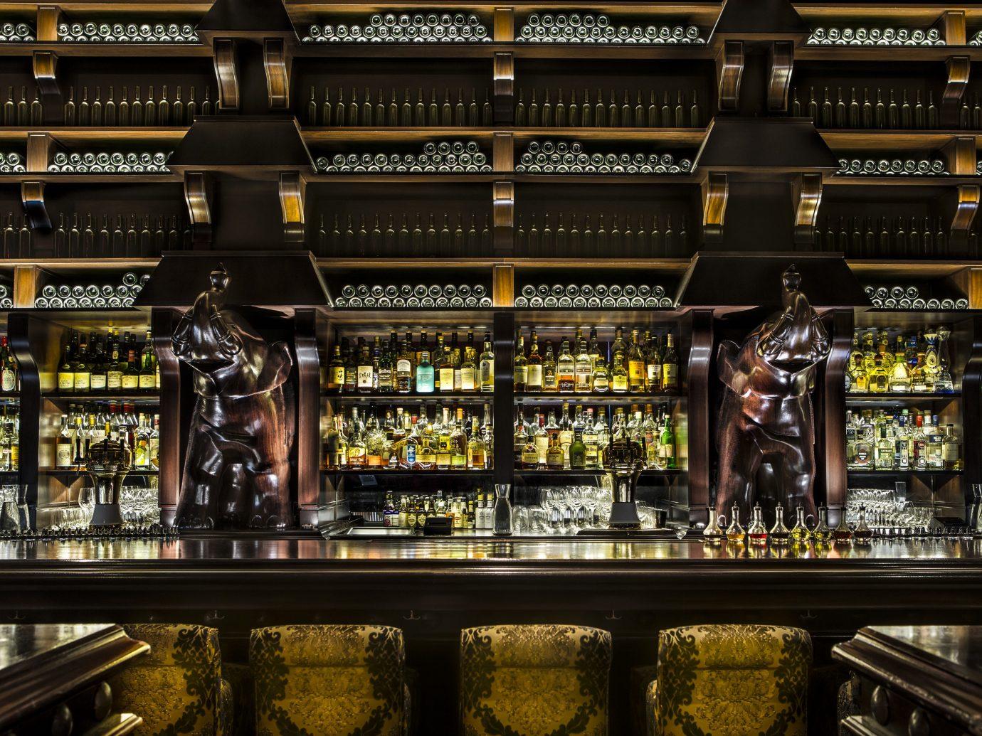 Offbeat Style + Design indoor building liquor store shelf Bar store beer bunch several