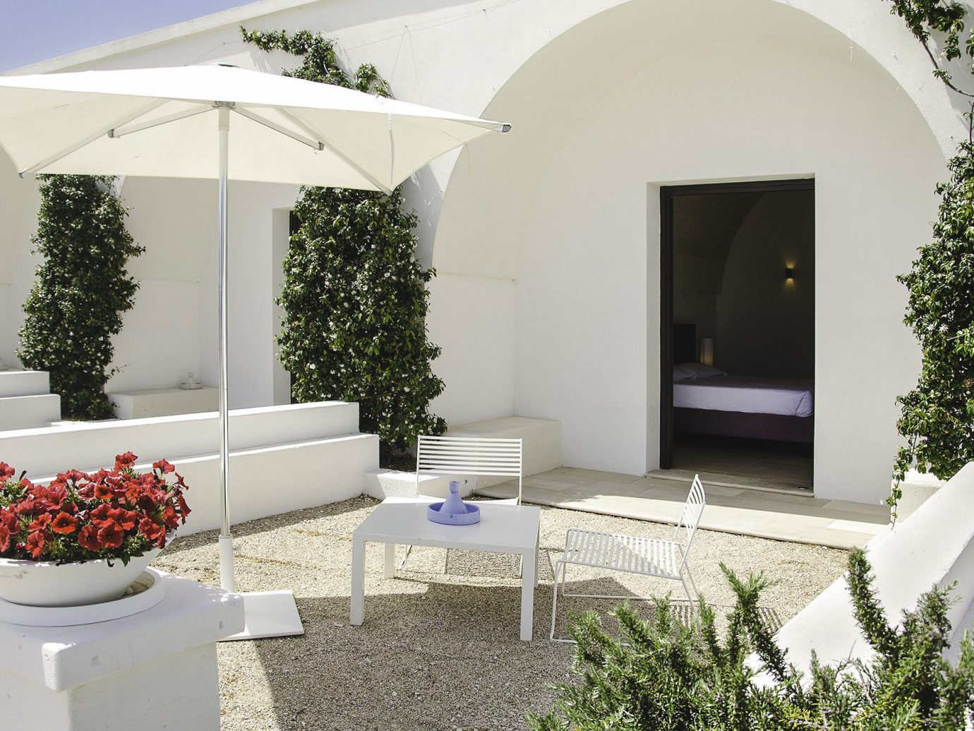 Boutique Hotels Hotels Trip Ideas tree property outdoor Architecture house real estate estate Courtyard Villa home shade outdoor structure backyard facade furniture