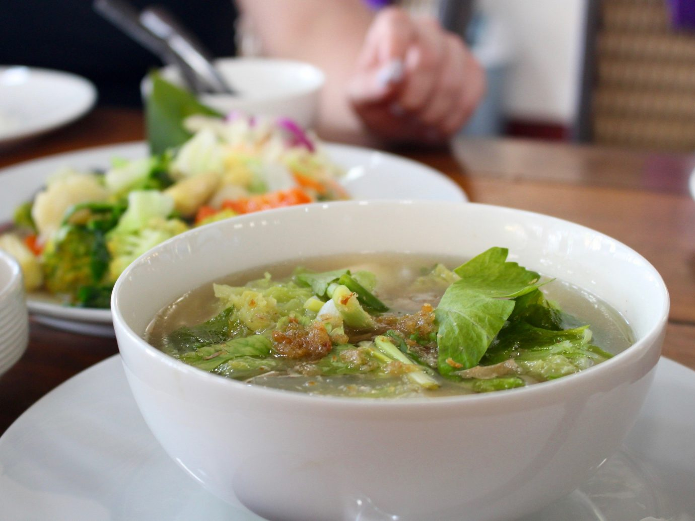 Jetsetter Guides table food plate dish indoor bowl cuisine soup meal lunch produce salad asian food pho southeast asian food chinese food