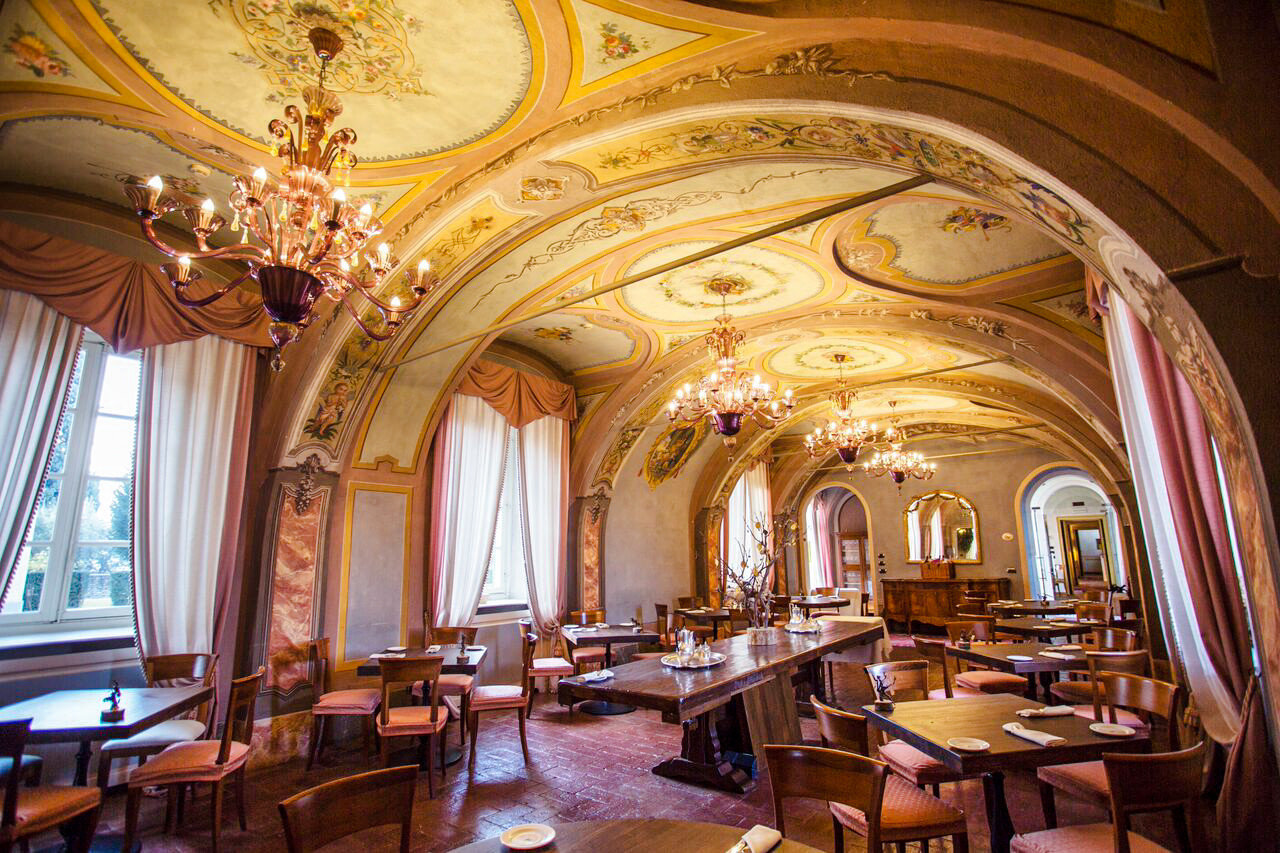 Food + Drink Hotels Italy Luxury Travel Trip Ideas indoor room function hall interior design chapel restaurant ceiling arch place of worship abbey vault hall high furniture several