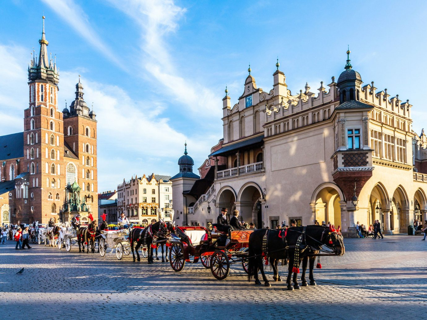 Trip Ideas outdoor building road sky street bicycle landmark Town City town square plaza Winter human settlement tourism cityscape season Downtown evening vehicle people palace drawn carriage square stone