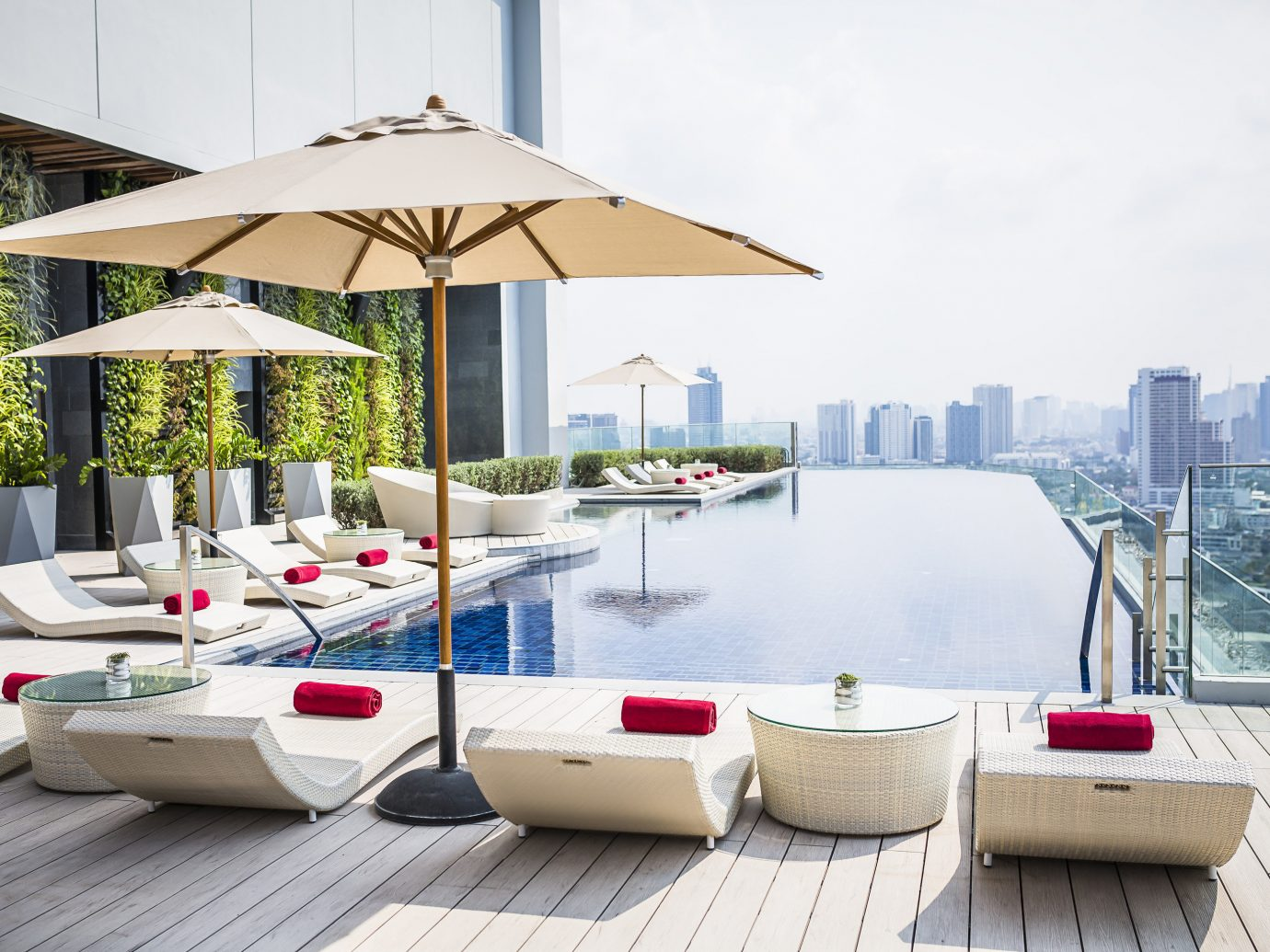 Hotels Jetsetter Guides Trip Ideas sky outdoor swimming pool outdoor structure Design umbrella table interior design backyard Villa