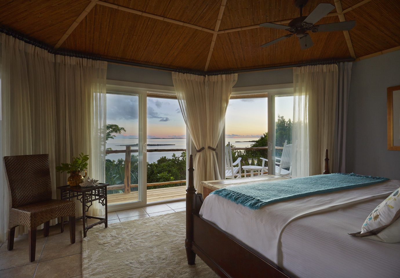 Bedroom with beach view at Fowl Cay Resort