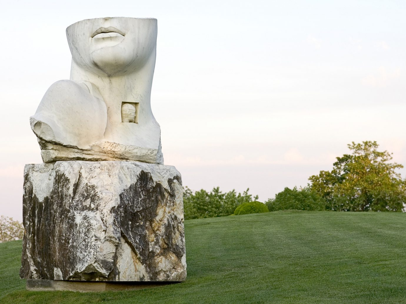 sky building grass outdoor sculpture megalith statue monument art rock ancient history monolith stone