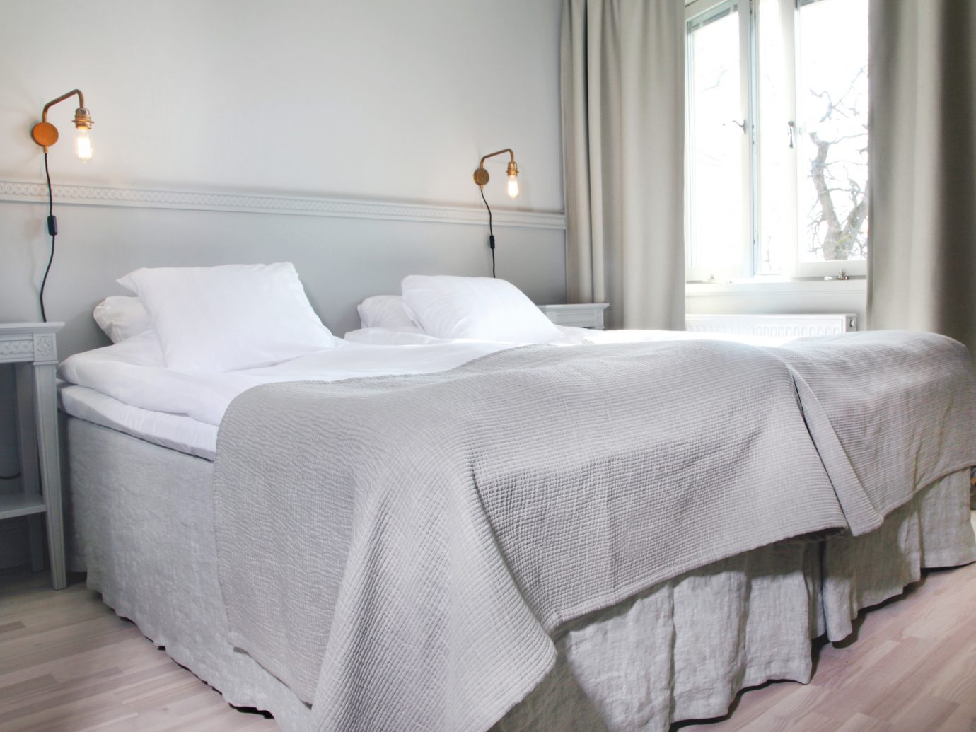 Denmark Finland Hotels Landmarks Luxury Travel Sweden indoor bed wall floor window room bed frame Bedroom hotel furniture mattress product home bed sheet bedding textile duvet cover interior design Suite linens flooring mattress pad comfort lamp