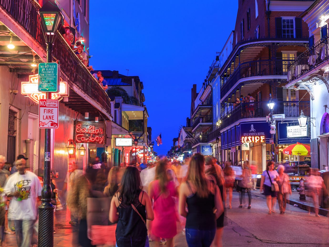 Girls Getaways New Orleans Trip Ideas Weekend Getaways building outdoor street color person crowd road Town City walking human settlement night vacation tourism market Downtown evening infrastructure way travel busy