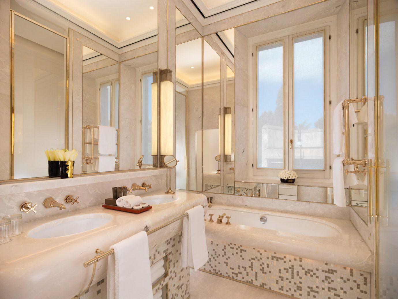 Boutique Hotels Hotels indoor bathroom wall window room property estate sink tub home floor Suite interior design bathtub real estate ceiling mansion cottage toilet Bath tan tile tiled