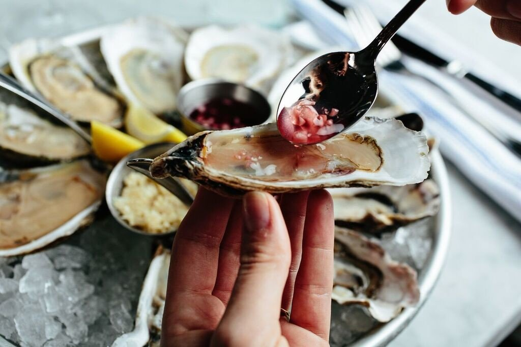 Eat food Food + Drink hand oysters Seafood plate dish meal oyster mussel fish invertebrate animal source foods clams oysters mussels and scallops produce breakfast