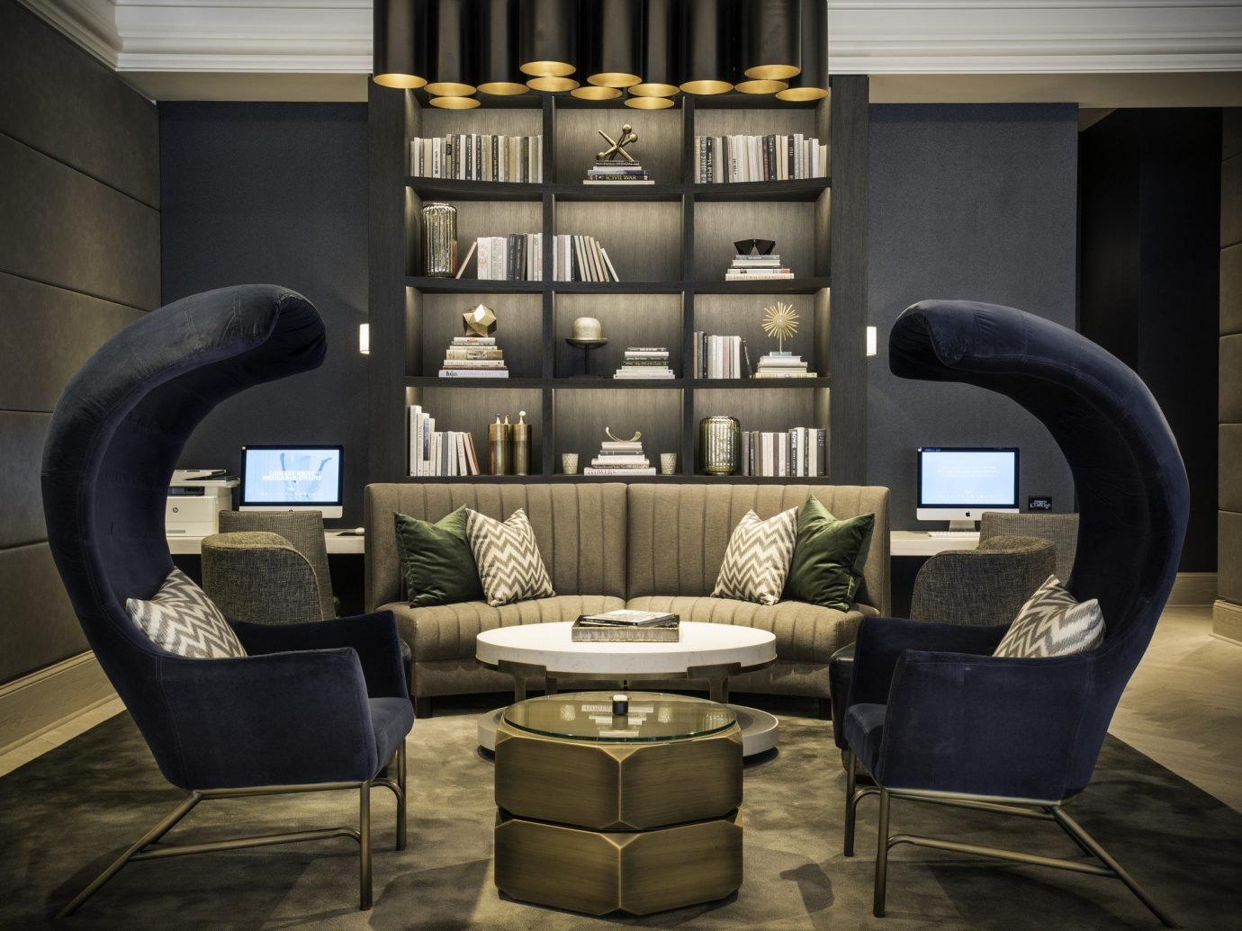 artistic artsy chic cozy Hip Hotels library living area Lounge Luxury neutral tones regal sophisticated trendy floor chair indoor living room furniture room interior design home Design table leather