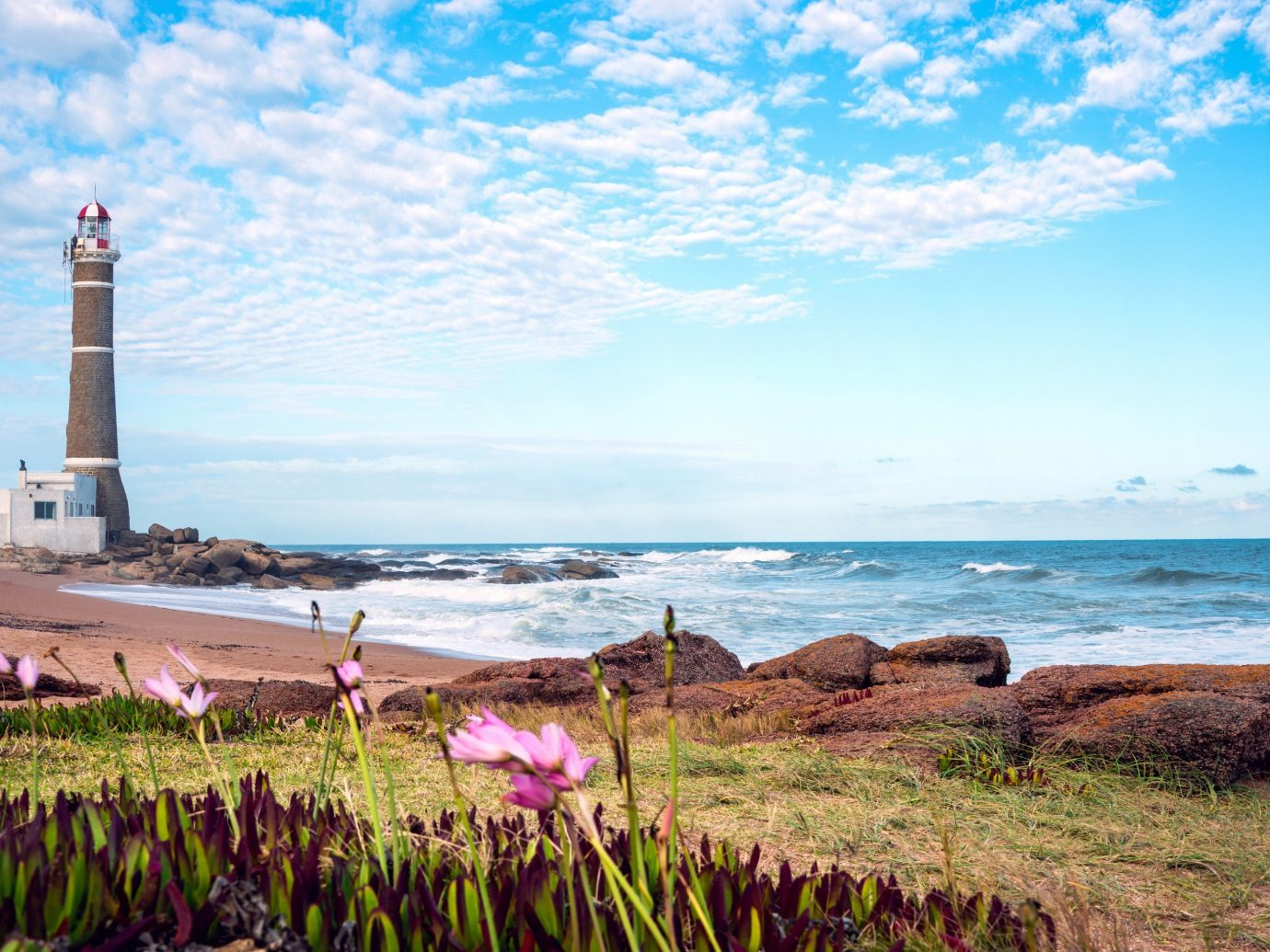 Travel Tips outdoor water grass shore Sea Coast tower Ocean body of water horizon lighthouse Nature Beach vacation cape bay cove overlooking stone