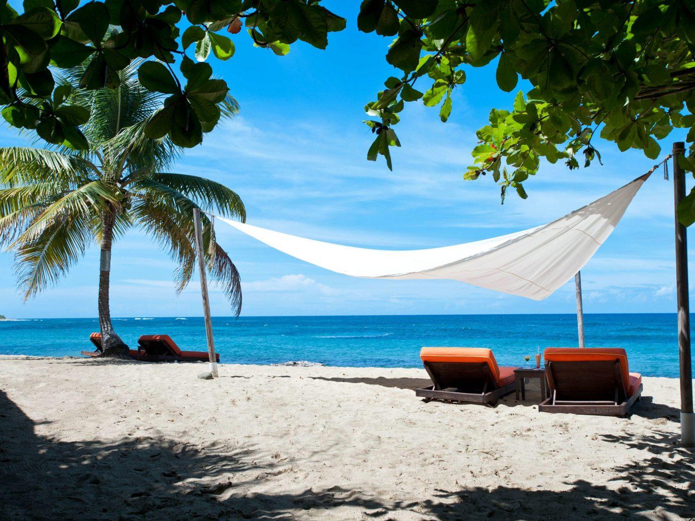 Trip Ideas outdoor sky water tree Beach umbrella shore chair body of water Sea Nature caribbean vacation Ocean tropics arecales palm bay Island Lagoon sandy shade lined day