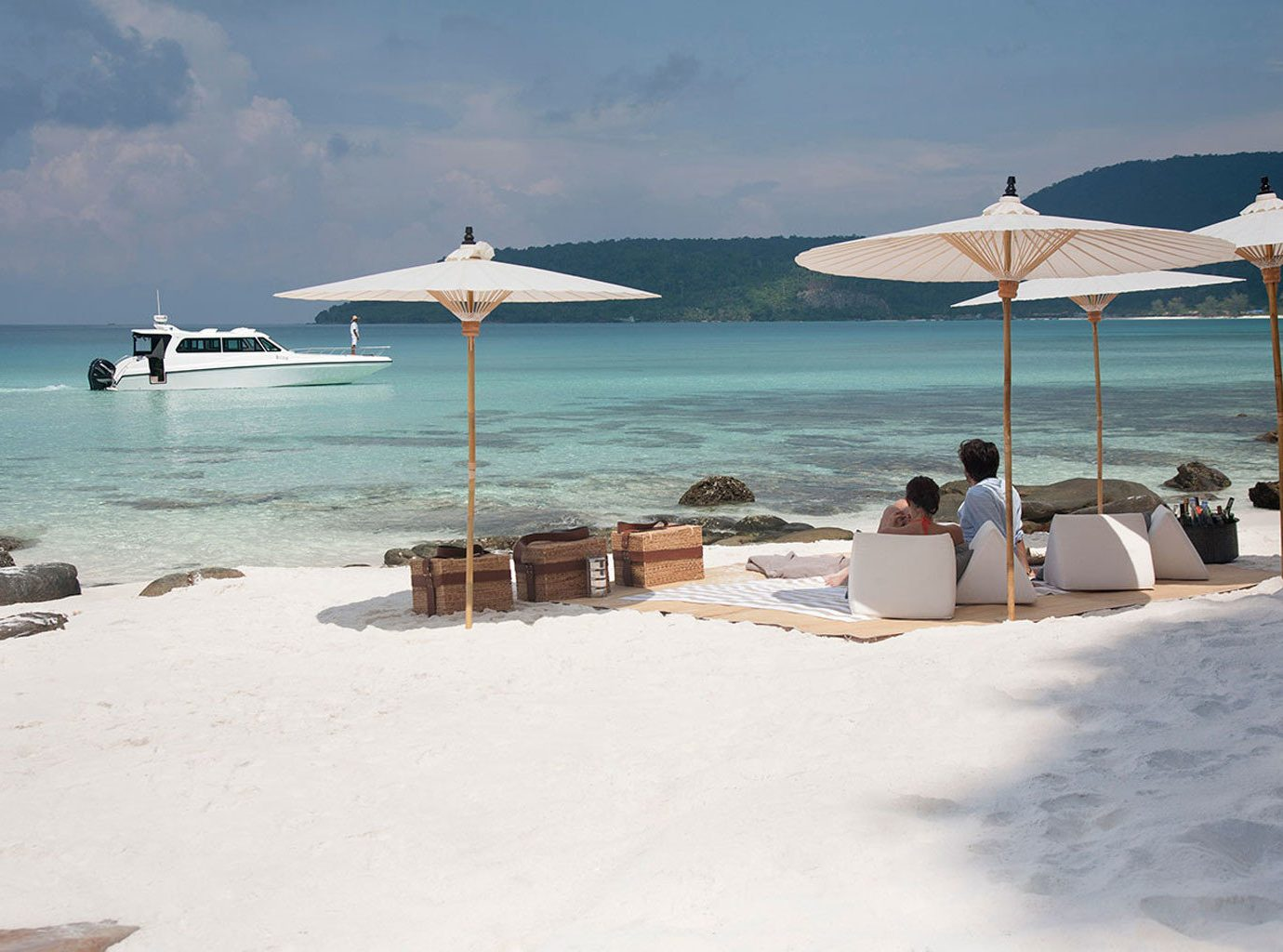 All-Inclusive Resorts Hotels Luxury Travel sky outdoor water umbrella Beach Sea chair shore body of water Nature Ocean vacation Coast vehicle bay Lagoon cape Island sand sandy day several