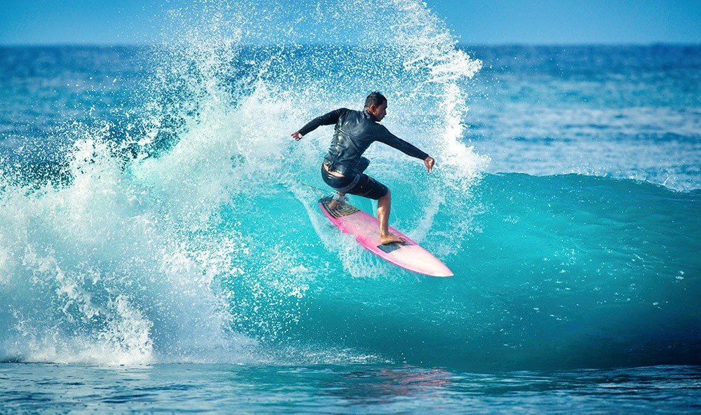 Health + Wellness Trip Ideas water wave surfing outdoor riding water sport Sport man Ocean sports wakesurfing wind wave surfboard boardsport surfing equipment and supplies surface water sports rider Sea extreme sport individual sports male