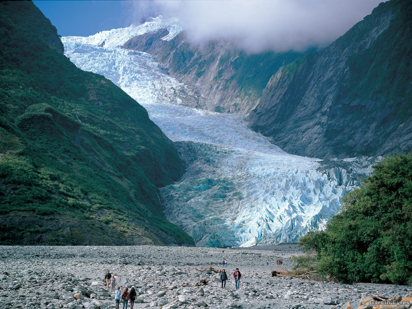Greenery Mountains Nature Oceania Outdoors remote snow Trip Ideas mountain outdoor geographical feature landform glacier fjord glacial landform geological phenomenon people moraine mountain range water feature cirque Sea