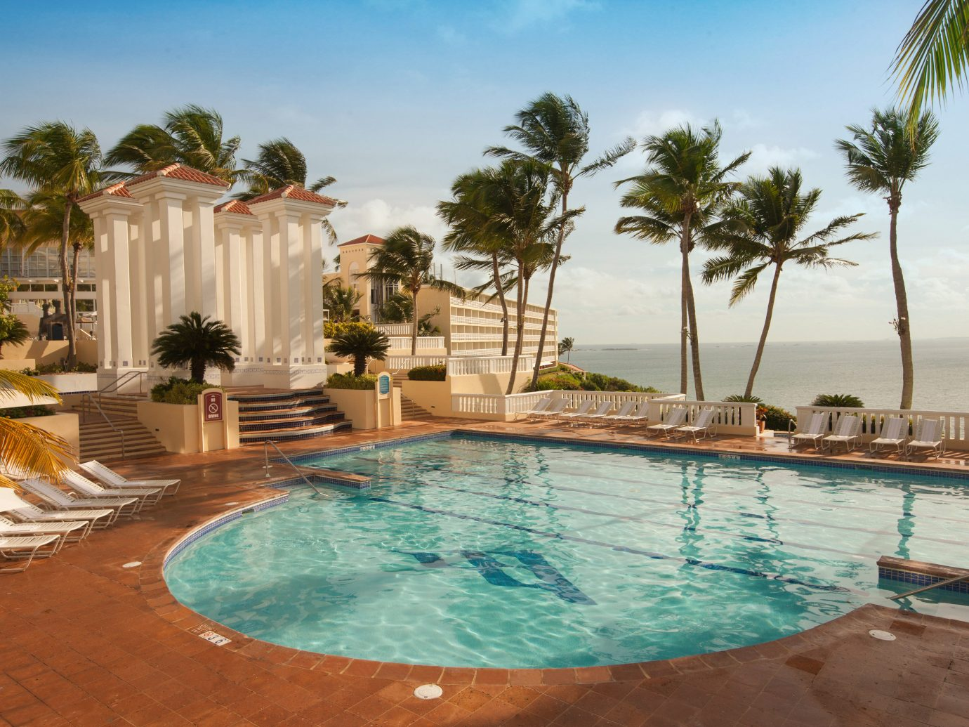 Hotels sky outdoor swimming pool Resort property vacation estate Pool Villa caribbean backyard real estate hacienda Lagoon palm swimming