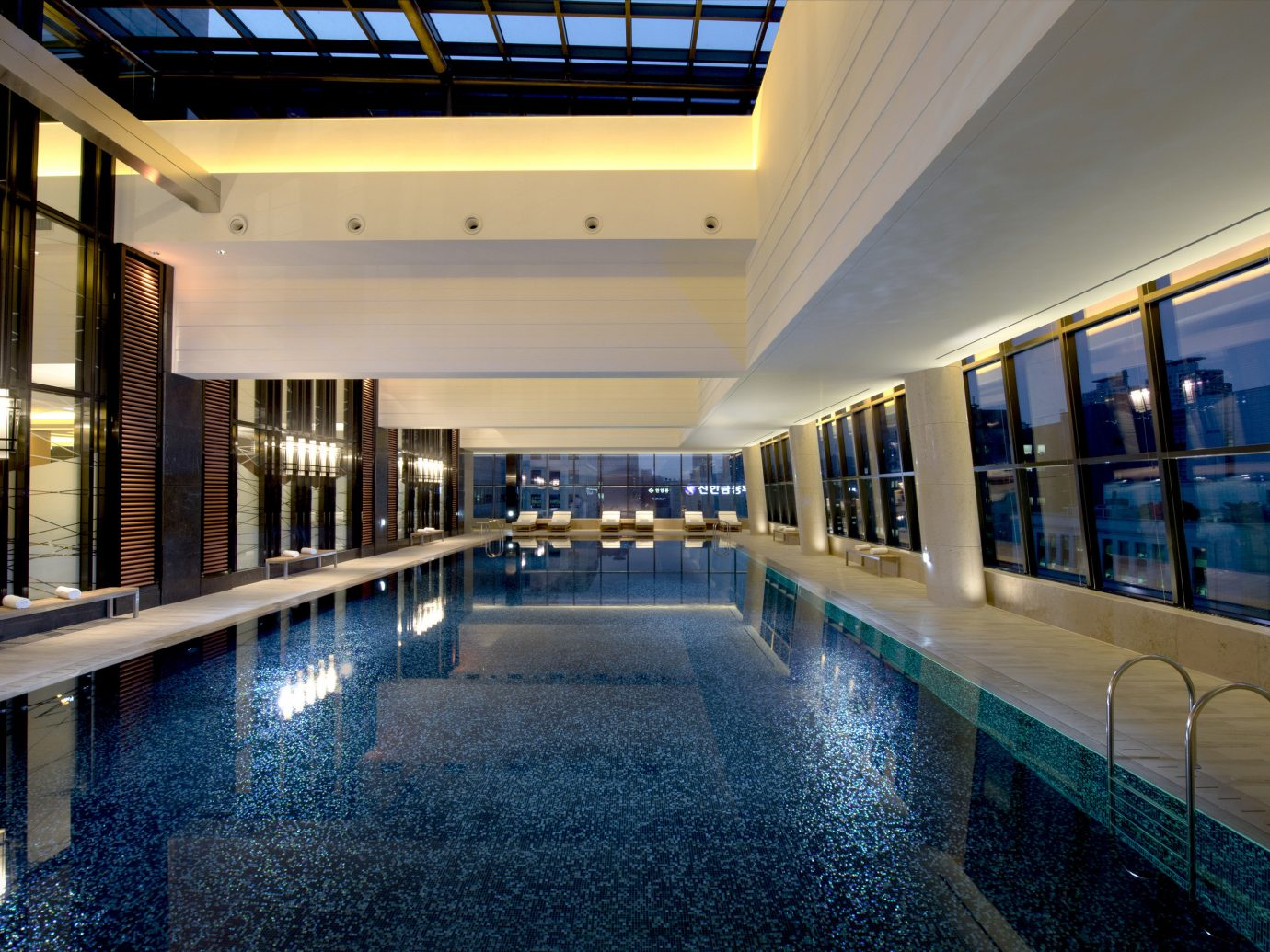 Hotels Luxury Travel indoor floor property ceiling swimming pool estate condominium Lobby real estate apartment reflection interior design leisure hotel daylighting Resort leisure centre water amenity window train long
