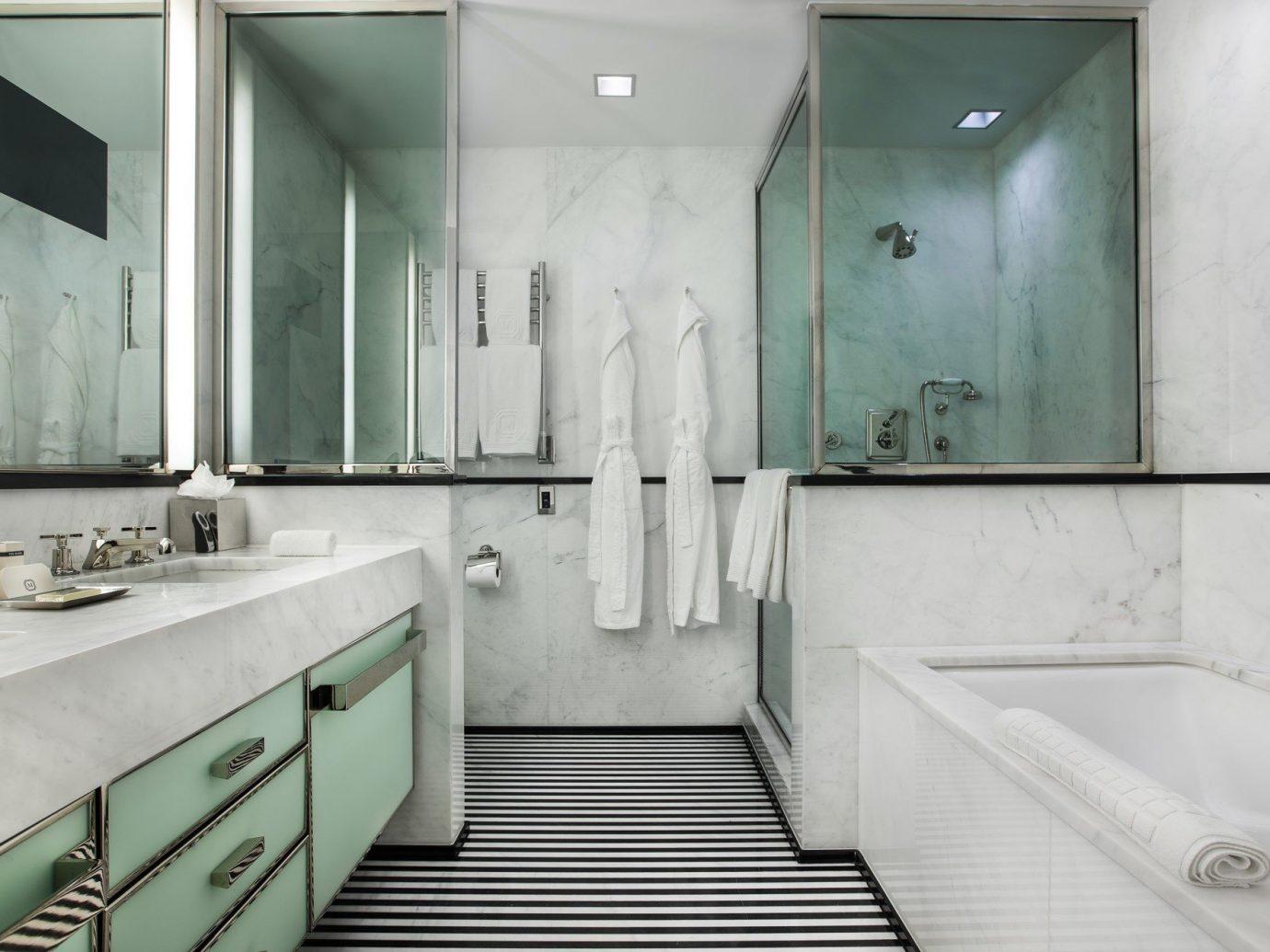 Hotels indoor wall bathroom room property floor interior design plumbing fixture toilet sink public toilet Design tub