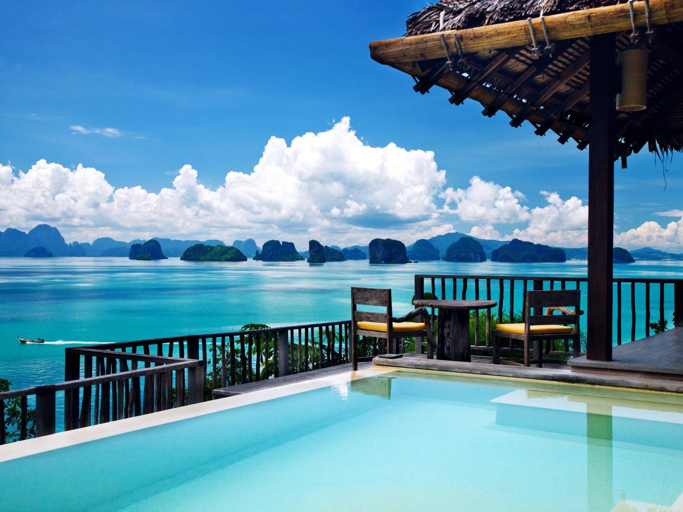 Hotels sky water outdoor leisure chair swimming pool vacation Resort Ocean Sea estate caribbean Pool bay overlooking swimming