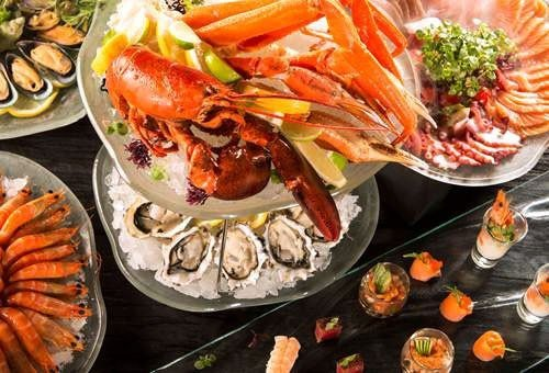 Food + Drink food plate dish Seafood cuisine meal fish buffet hors d oeuvre invertebrate asian food seafood boil animal source foods different meat variety