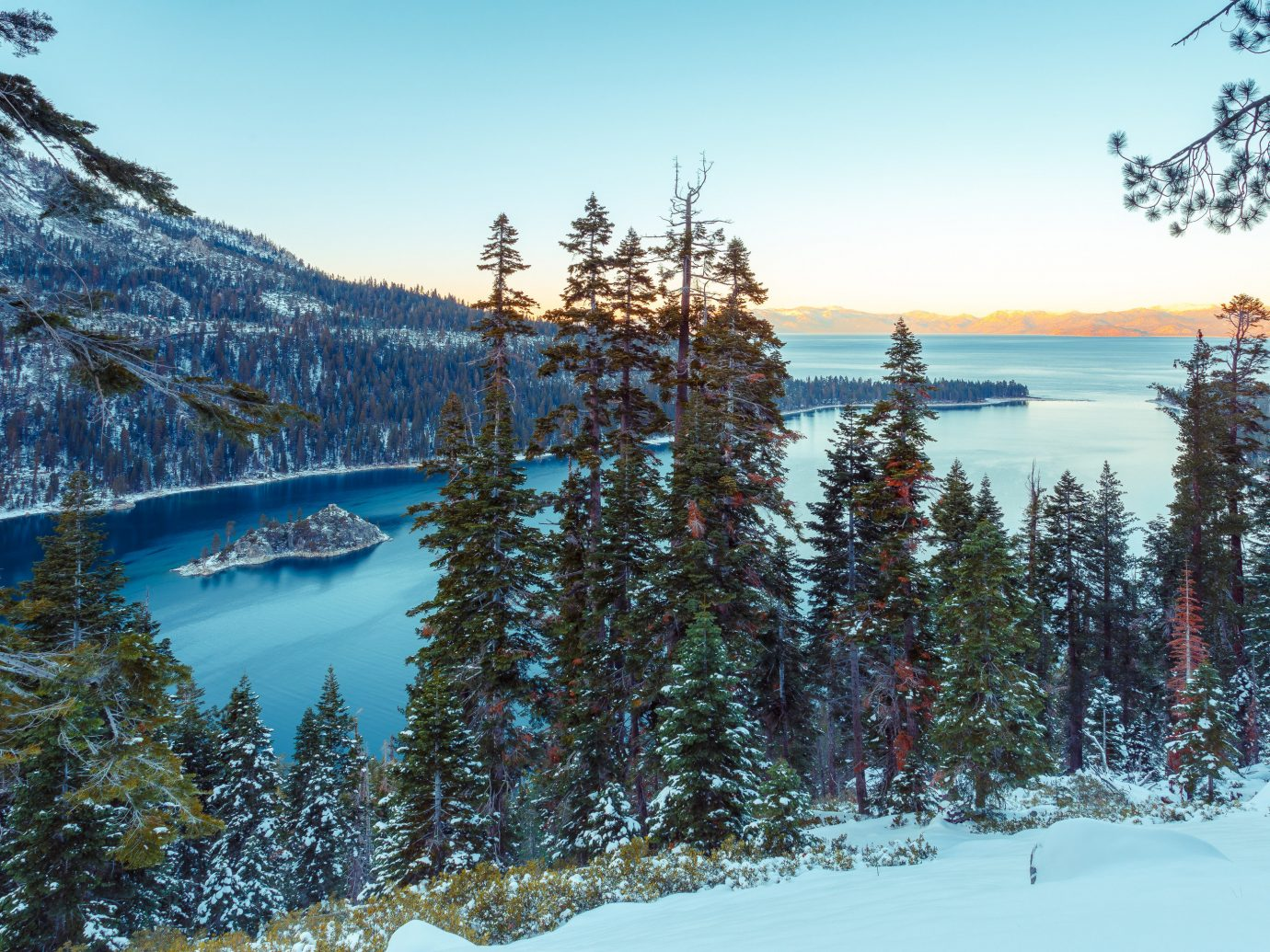Hotels Mountains + Skiing Trip Ideas tree outdoor sky snow mountainous landforms Winter Lake wilderness Nature mountain season mountain range slope conifer Forest wooded hillside