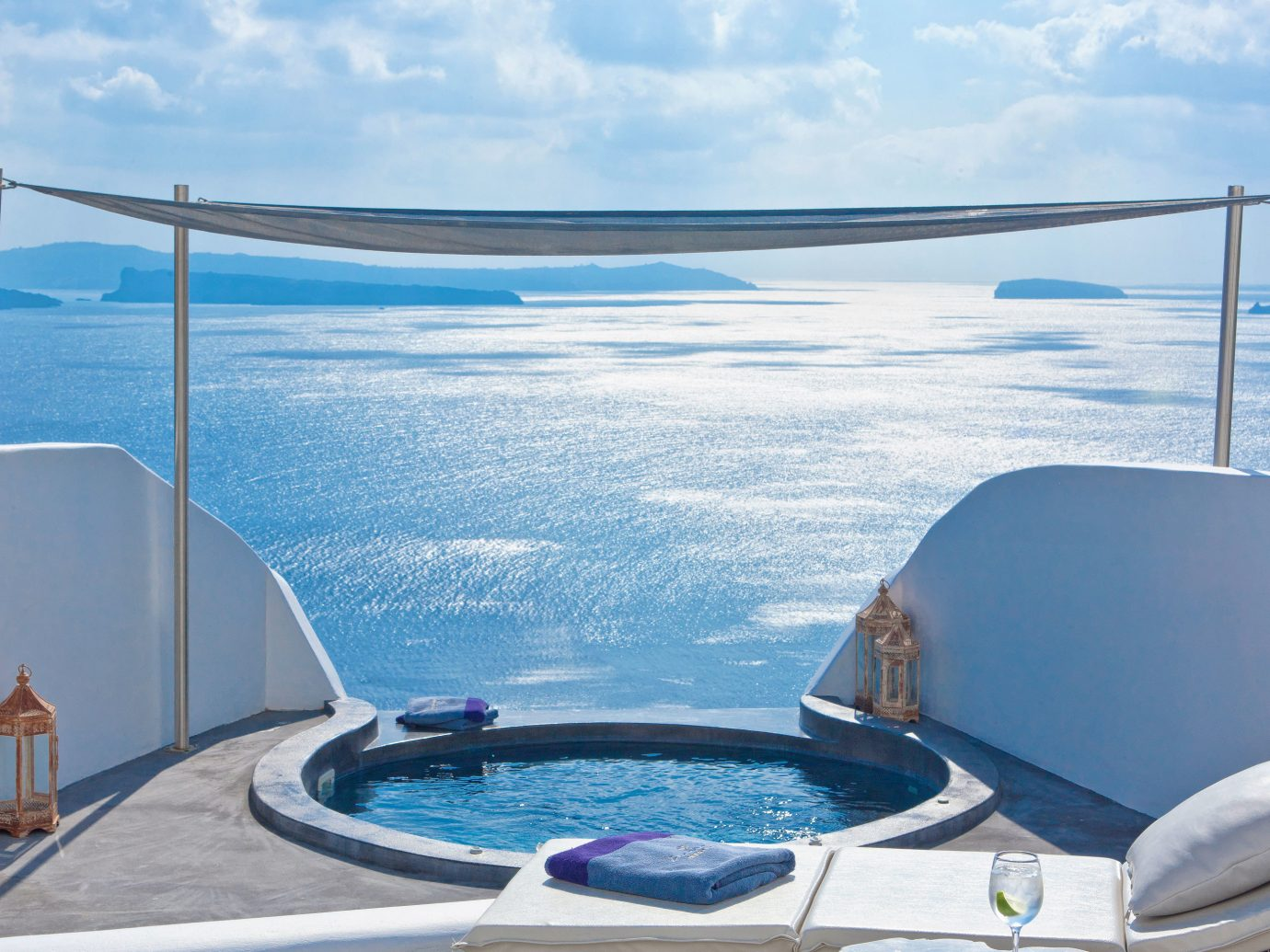Balcony Classic Elegant Greece Hot tub/Jacuzzi Hotels Island Luxury Romantic Santorini Scenic views Suite Trip Ideas Waterfront sky water outdoor swimming pool yacht Boat vehicle vacation Ocean overlooking passenger ship Sea bed jacuzzi Deck day