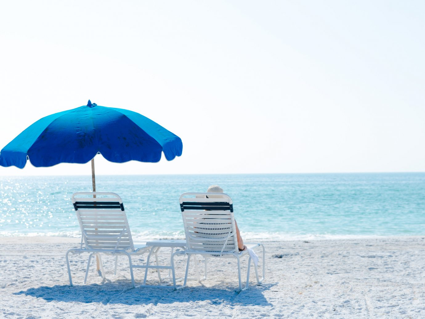 Trip Ideas umbrella outdoor sky chair accessory Nature blue Sea Ocean fashion accessory Beach shore lawn