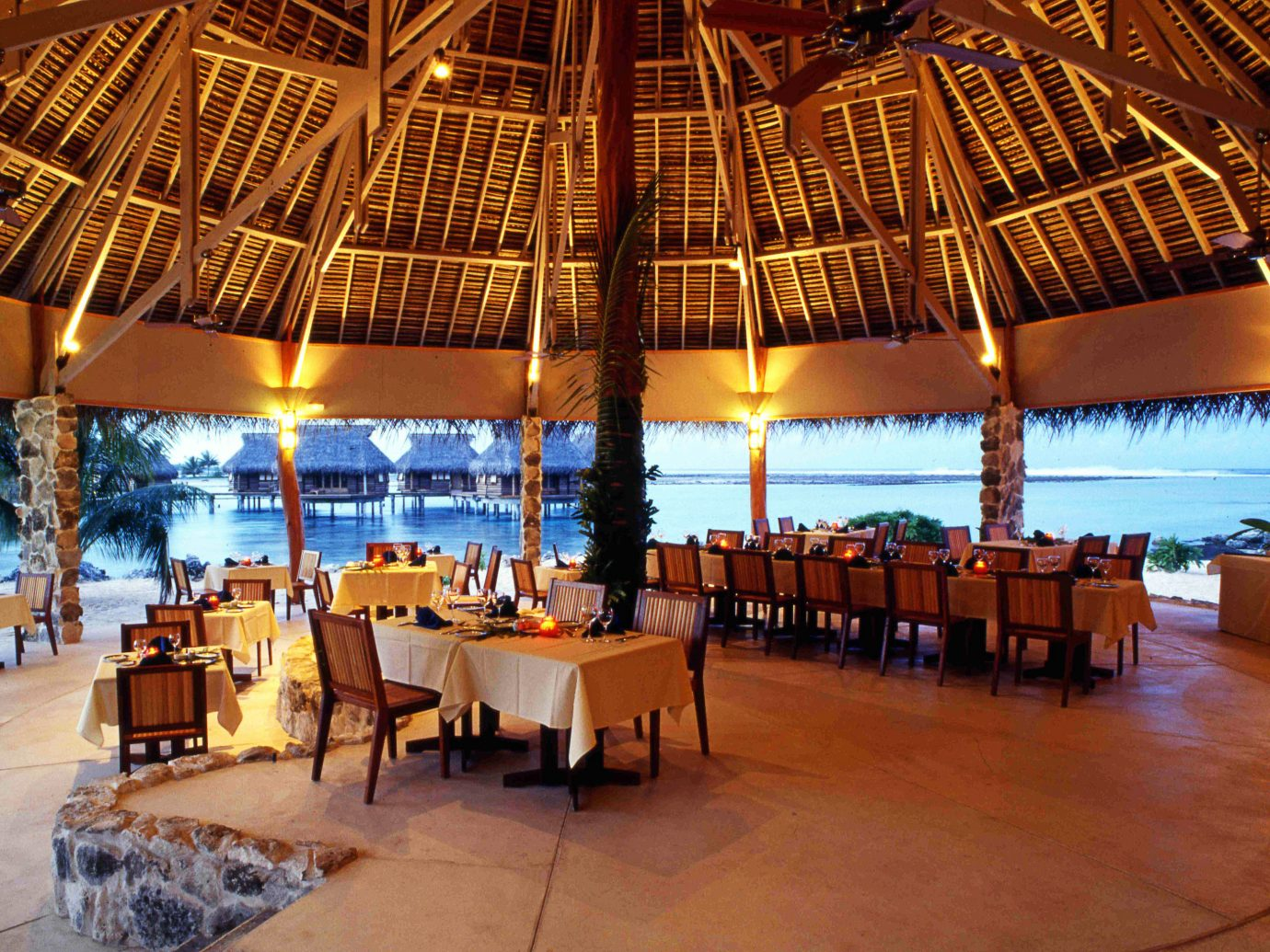 All-Inclusive Resorts Beachfront Boutique Hotels Cultural Dining Drink Eat Hotels Overwater Bungalow Resort Romance table floor chair restaurant estate palace several