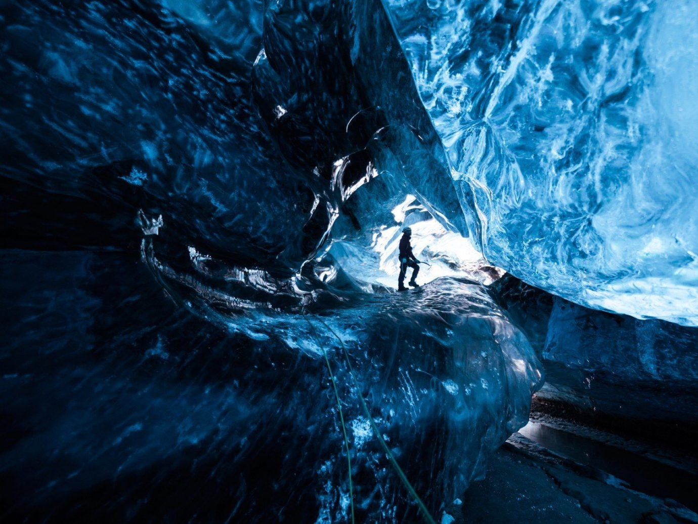Offbeat Trip Ideas ice cave blue landform geographical feature cave ice extreme sport glacial landform screenshot formation sea cave