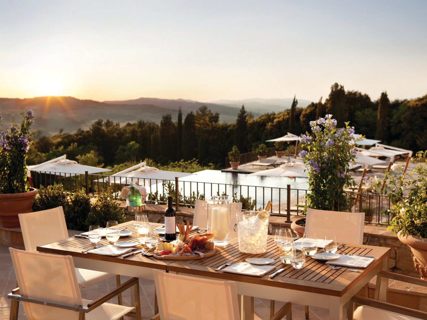tree table sky outdoor meal restaurant estate Resort set surrounded several