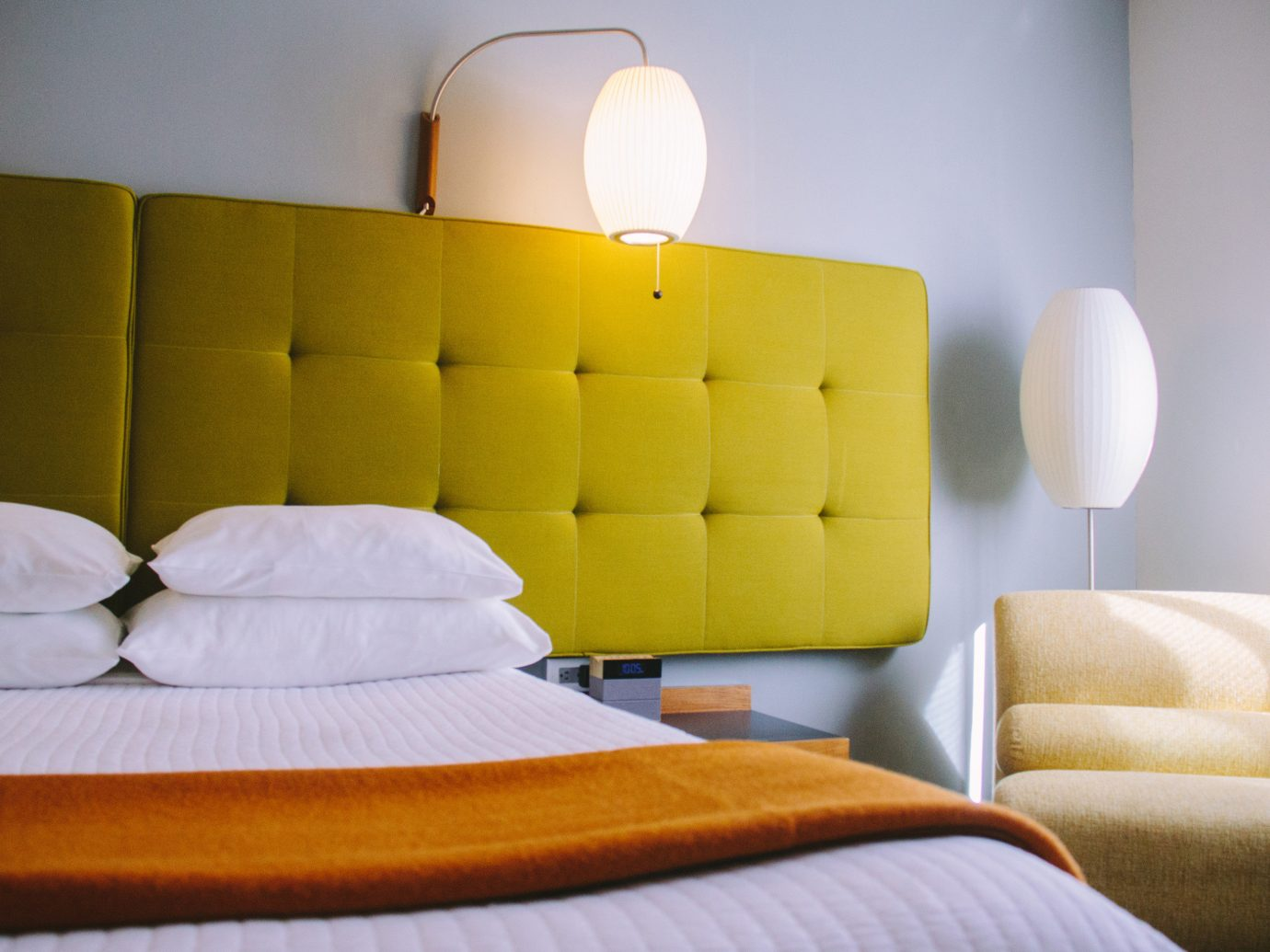 Boutique Hotels Fall Travel Trip Ideas Weekend Getaways indoor wall yellow furniture room couch interior design bed bed frame Bedroom Suite lighting ceiling product design home comfort bed sheet table sofa bed living room product angle mattress floor hotel sofa