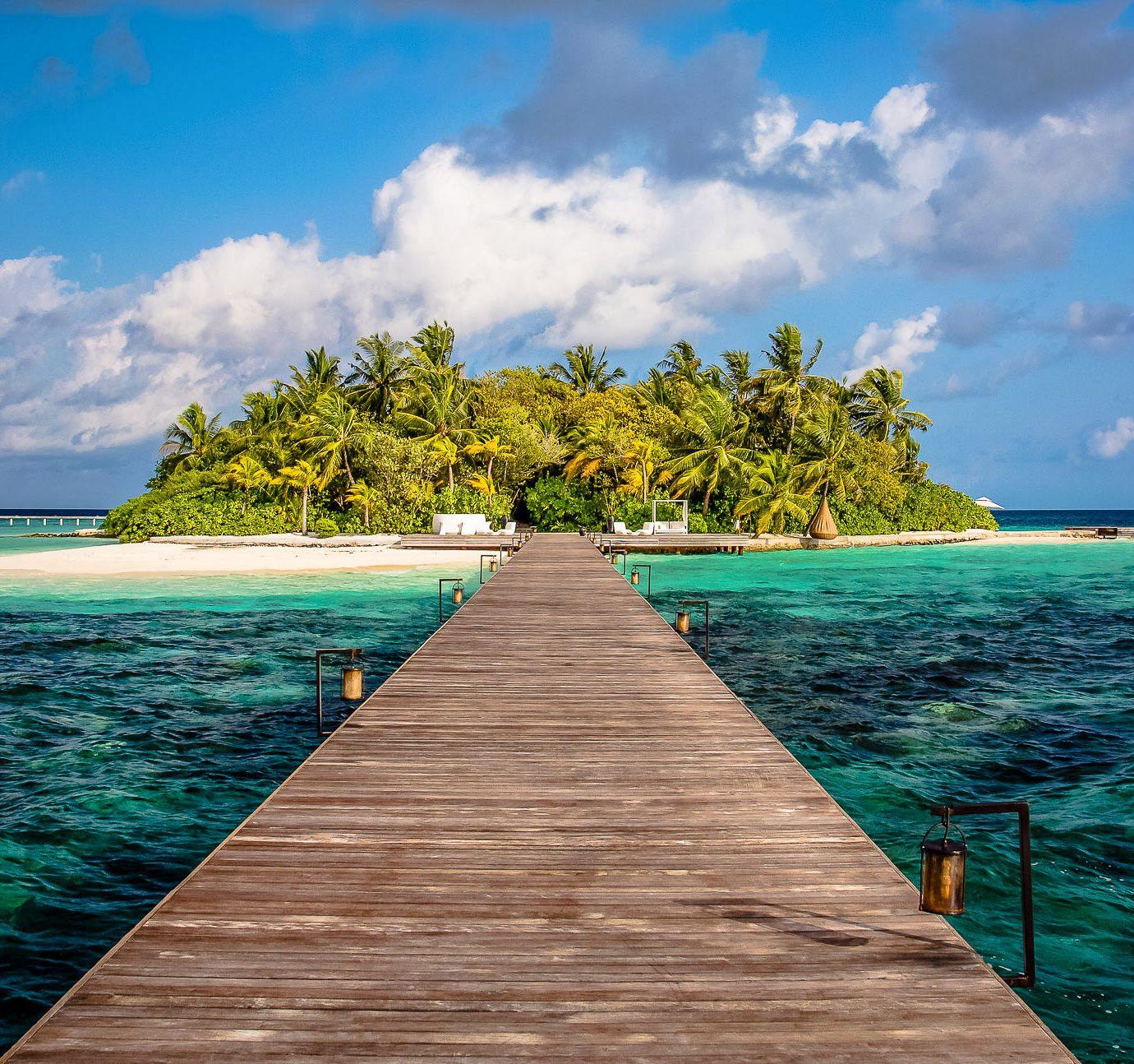 wooden bridge to an island at Coco Privé, Maldives