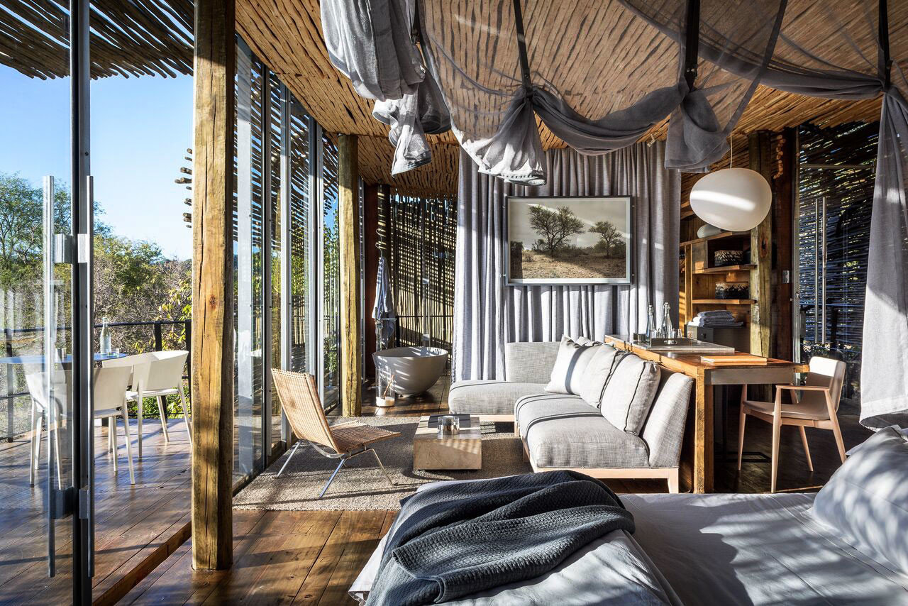 Luxury Travel Outdoors + Adventure Safaris Trip Ideas indoor property room house home bed estate porch living room interior design real estate cottage wood Resort outdoor structure mansion Bedroom furniture