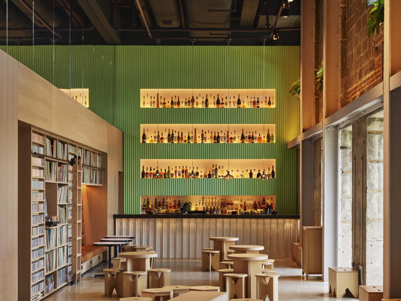 ambient lighting artistic artsy Bar bar seating Boutique cozy Hip Hotels industrial library Lounge Luxury Modern natural light trendy floor indoor Lobby interior design public library wood Design tourist attraction furniture