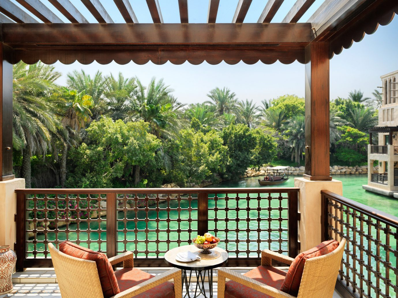 Dubai Hotels Luxury Travel Middle East property real estate outdoor structure estate Patio Balcony backyard Resort home roof window pergola apartment hacienda shade house