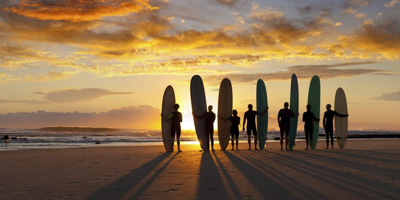 Health + Wellness Trip Ideas outdoor sky water Beach surfing horizon Sunset sunrise shore Sea cloud Ocean Coast dawn evening morning dusk sunlight afterglow reflection wave Sun clouds sandy