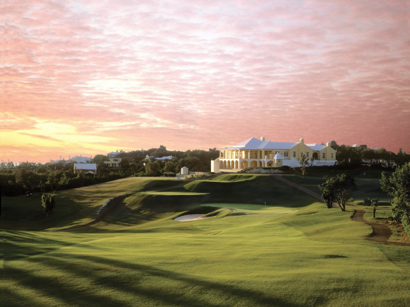 Beachfront Elegant Exterior Golf Grounds Hotels Island Scenic views Sport Sunset Tropical Waterfront outdoor sky grass structure sport venue golf course cloud field golf club Nature sports lawn dusk day