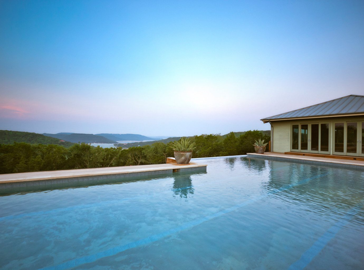 Hotels water sky outdoor Nature swimming pool property estate vacation house Pool Lake reflection Sea Lagoon Resort shore swimming