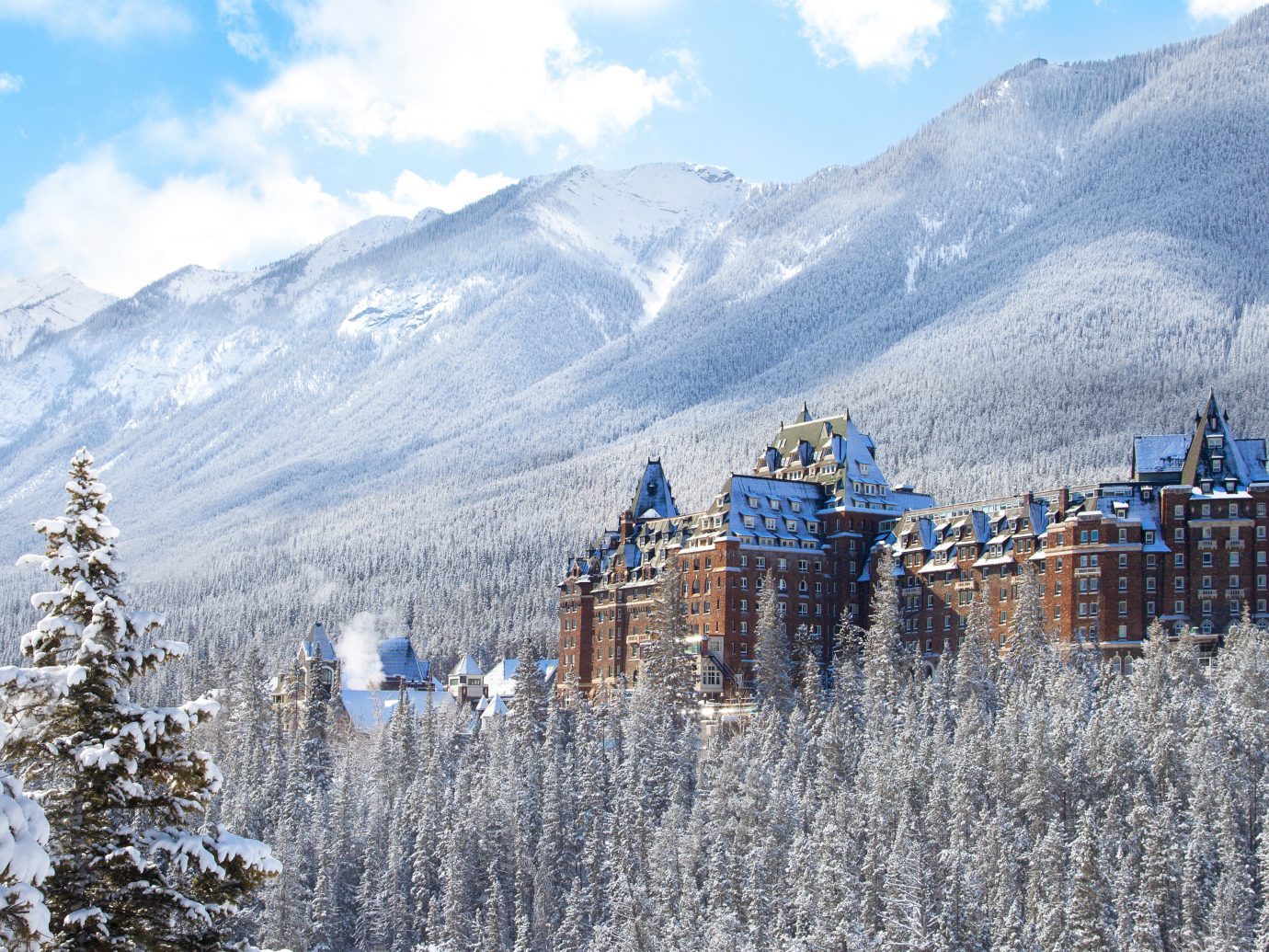 Alberta Architecture Boutique Hotels Buildings Canada Exterior Hotels Mountains Outdoors Resort Scenic views Trip Ideas outdoor mountain sky mountainous landforms snow Winter Nature mountain range wilderness weather season alps frost ridge highland