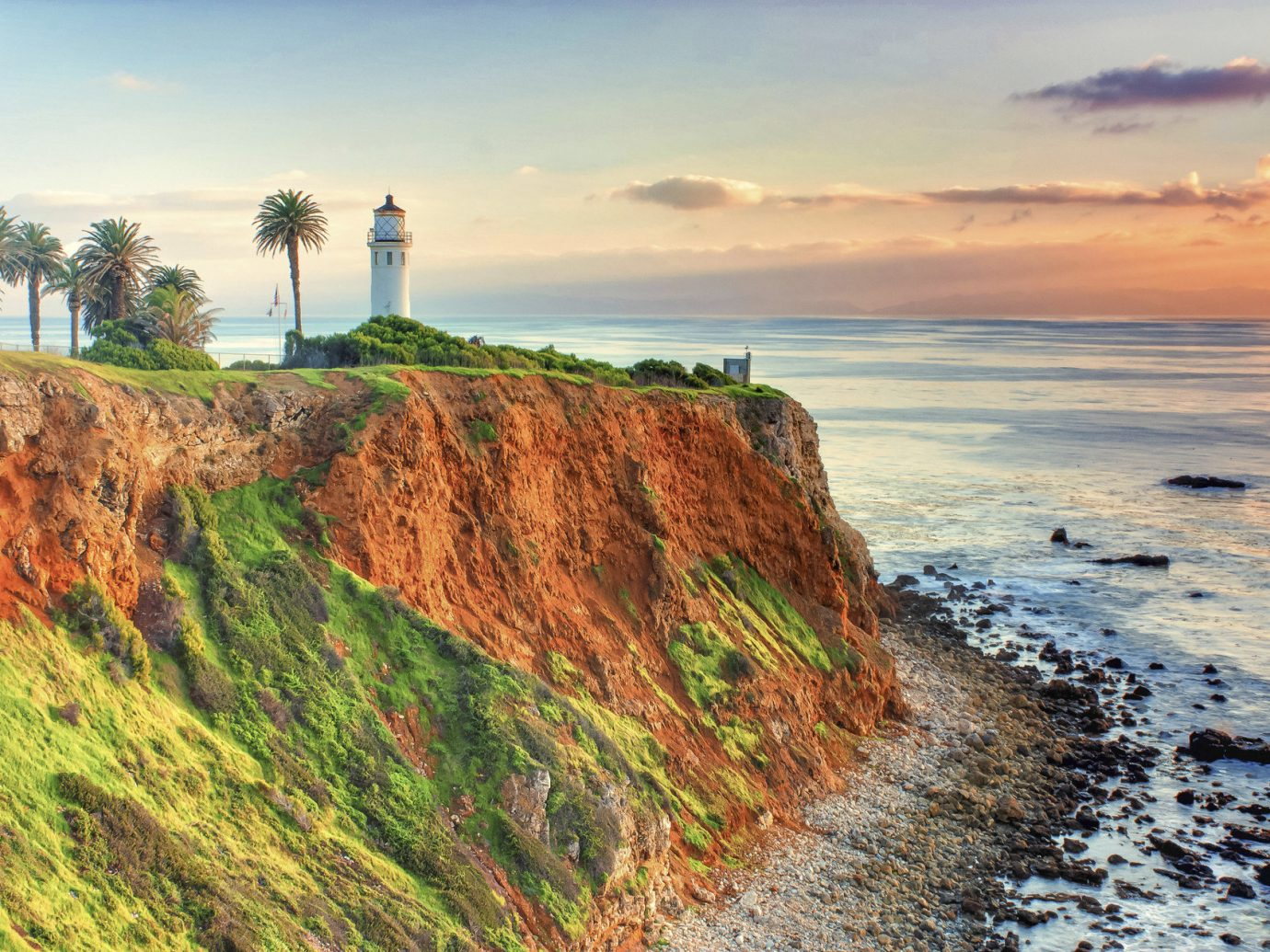 sky outdoor Coast cliff shore tower Sea Nature lighthouse Ocean horizon rock Beach terrain hill cloud cape landscape cove wave bay waterway Sunset