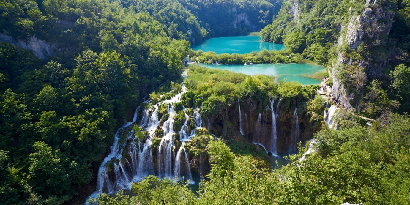 Trip Ideas tree outdoor mountain Waterfall Nature body of water water feature River park Forest rainforest reservoir national park fjord Lake hillside surrounded wooded lush