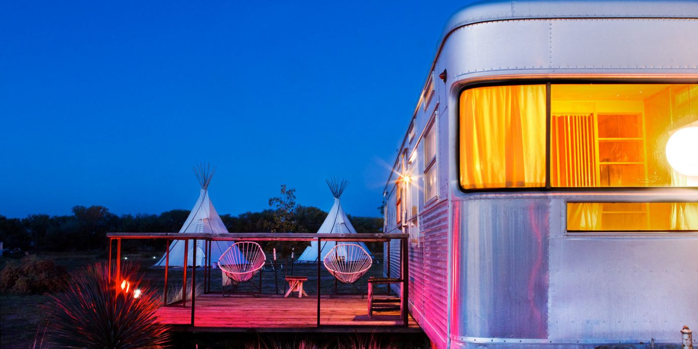 Glamping Luxury Travel Outdoors + Adventure sky outdoor transport vehicle night evening light