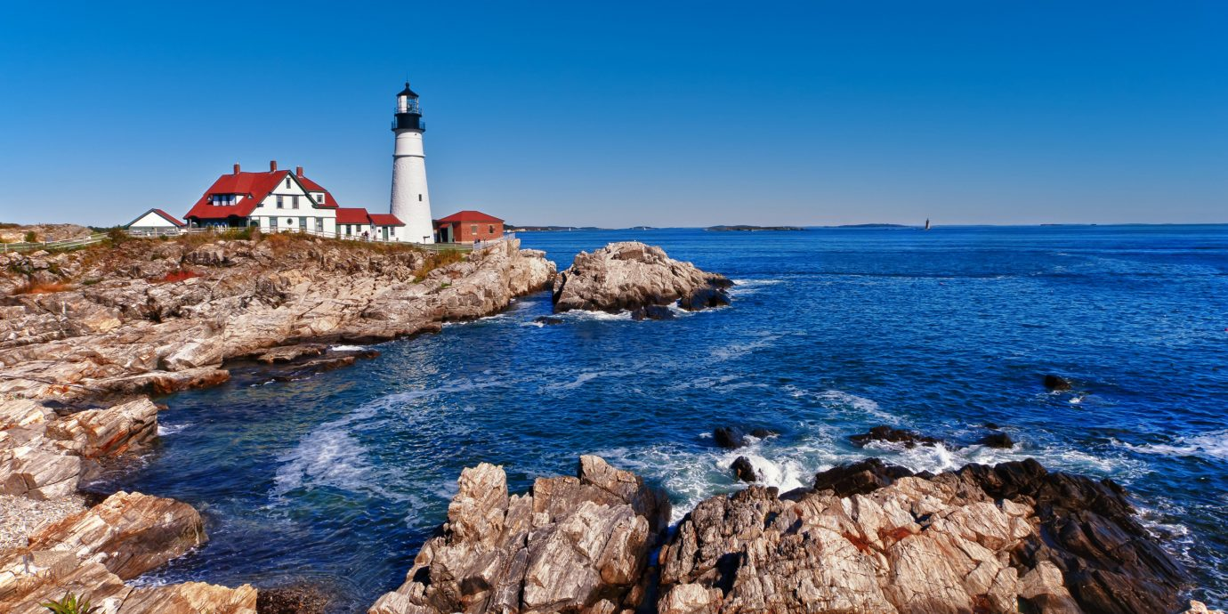 sky outdoor water rock tower rocky Coast shore Sea lighthouse Ocean Nature mountain cliff horizon cove vacation cape bay terrain Beach stack wave promontory Island stone