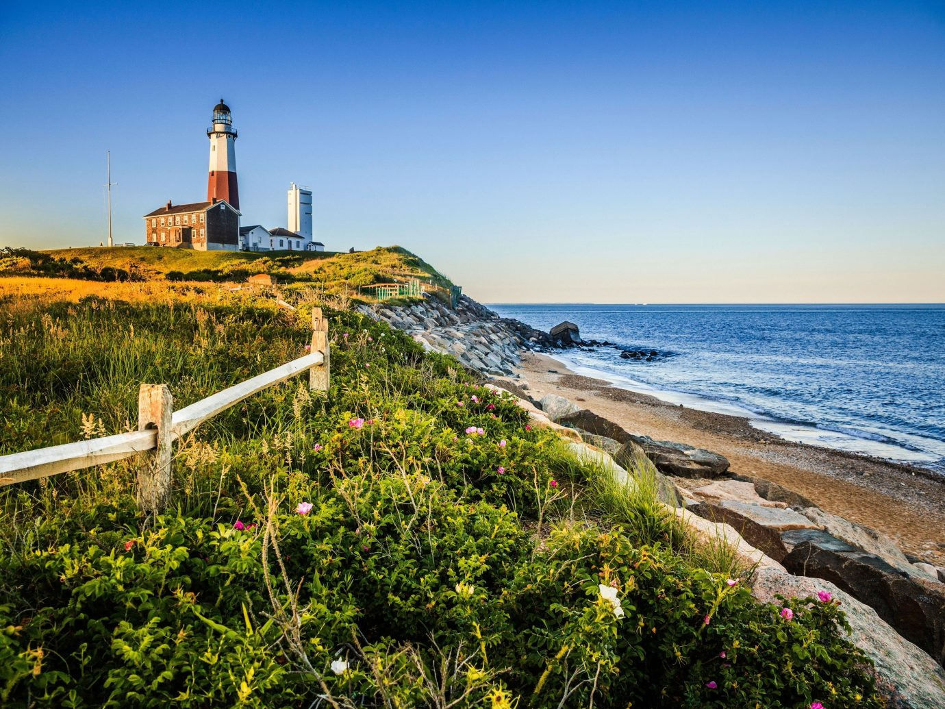 Trip Ideas sky outdoor grass water Coast tower shore Sea lighthouse Ocean horizon Beach vacation tourism cape bay landscape cove cliff terrain overlooking